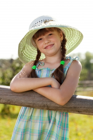 blithe: Dark-haired girl in a wicker hat with braids