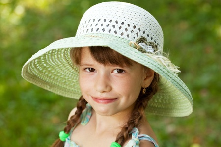 blithe: Happy girl with braids in the wide-brimmed hat