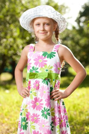 Charming blue-eyed girl in a hat and summer dress Stock Photo - 14796542