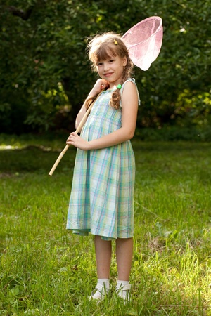 butterfly net: Funny, dark-haired girl with a butterfly net for catching butterflies