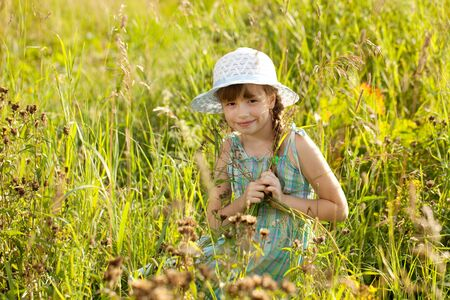 coquettish: Coquettish girl is hiding among the grass