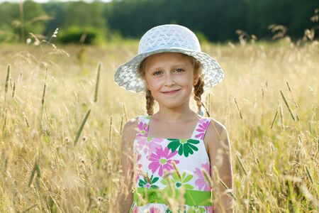 honey blonde: Blonde girl among the wildflowers and grasses