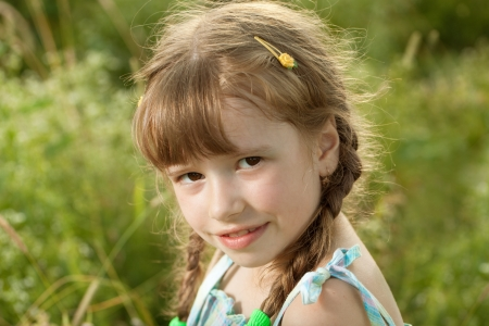 Flirtatious dark-haired girl with pigtails and a dress photo
