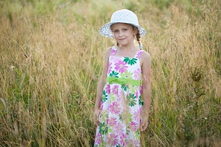 Cute little girl in a summer hat