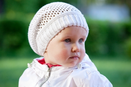 Charming babe in a white jacket and beret Stock Photo - 14842880