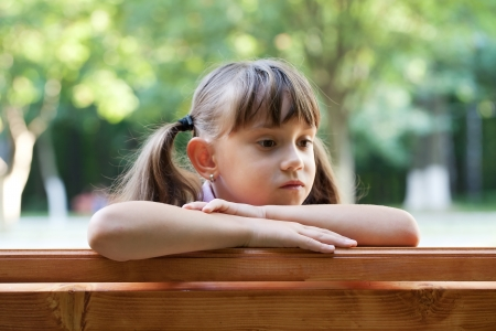 Little girl sits and thinks about something Stock Photo - 14882809