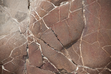 hardwearing: Surface of a large brown stone with cracks