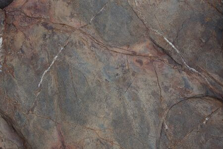 firmness: Brown stone with cracks on the surface roughness Stock Photo