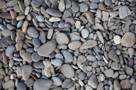 Fragment of the beach with lots of pebbles photo