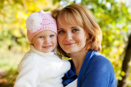 goodliness: Happy little girl with her young mother Stock Photo