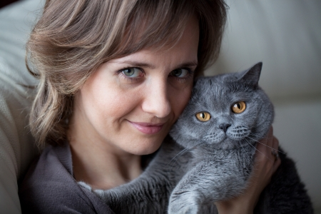 Pretty young woman with a cat in her arms Stock Photo - 15563091