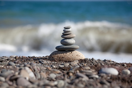 Pyramid of sea pebbles, composed by the sea photo