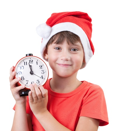 Girl in a Santa Claus hat and alarm clock Stock Photo - 15719814