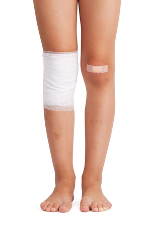 painfully: Injured foot in bandages and plaster on white background Stock Photo