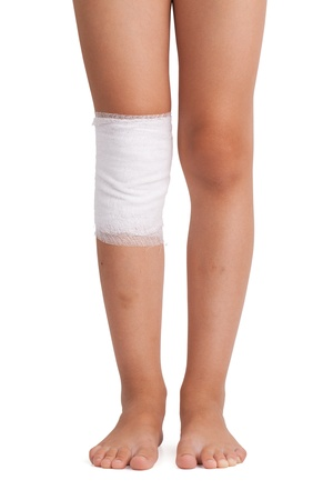 Legs, one of which was bandaged with a bandage photo