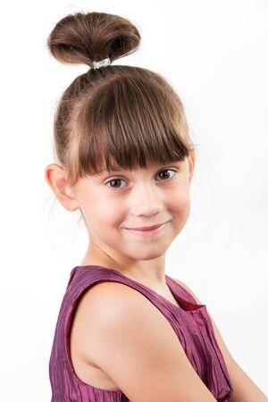 blithe: Cute little girl in a burgundy dress on light gray background Stock Photo