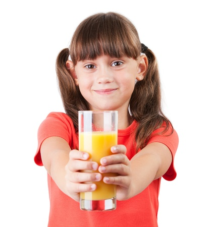 Little girl with orange juice in his outstretched hands photo