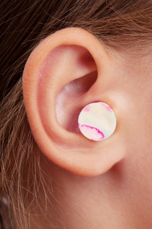 Ear plugs are inserted into the ear