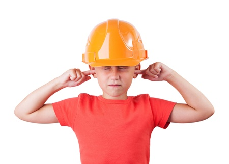 Little girl in a helmet tucked fingers in his ears Stock Photo - 15951864