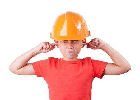 Little girl in a helmet tucked fingers in his ears Stock Photo - 15951864