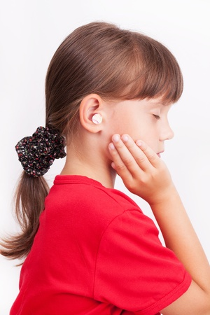 vestibular: Girl with ear plugs in your ears with your eyes closed Stock Photo