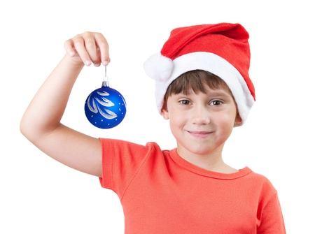 blithe: Girl in the image of Santa Claus holding a Christmas toy Stock Photo