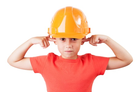 exasperation: Little girl in a protective helmet tucked her ears Stock Photo