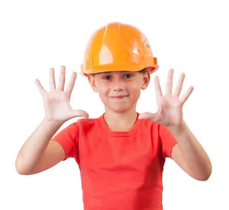 millwright: Cheerful child in a protective helmet shows palms