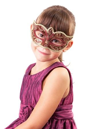 Cute little girl in a dress and carnival mask Standard-Bild