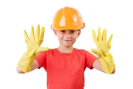 blithe: Ni�a en el casco de la construcci�n y guantes de goma Foto de archivo