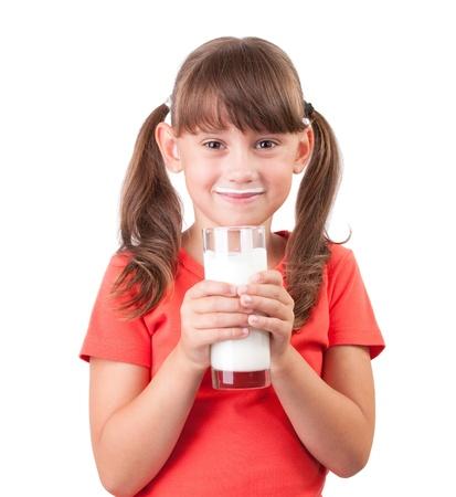 milk mustache: Little girl with a glass of fresh buttermilk