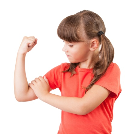 Little girl touches the biceps on his arm