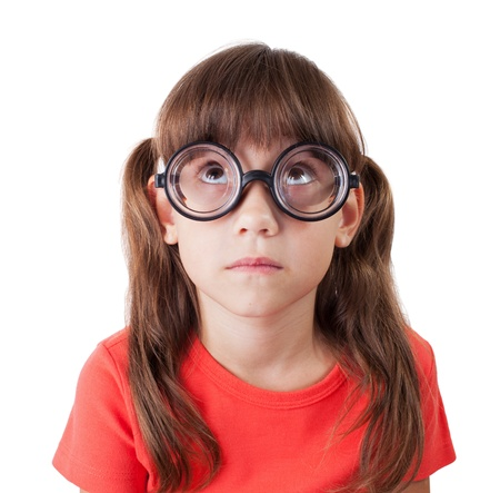hyperopia: Little girl in round spectacles stares up Stock Photo