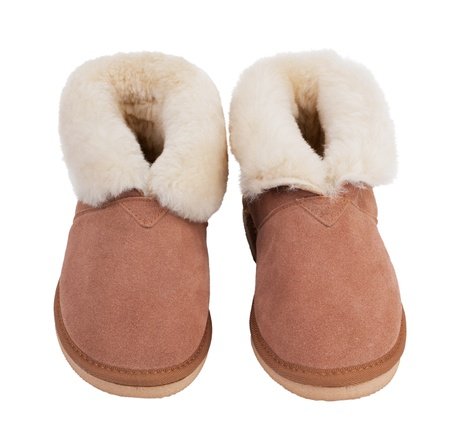 Warm slippers of wool on a white background photo