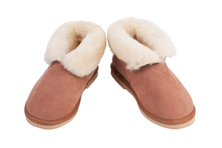 Pair of warm slippers of wool on a white background photo