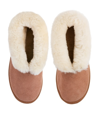 Two home warm sheepskin slippers on a white background photo
