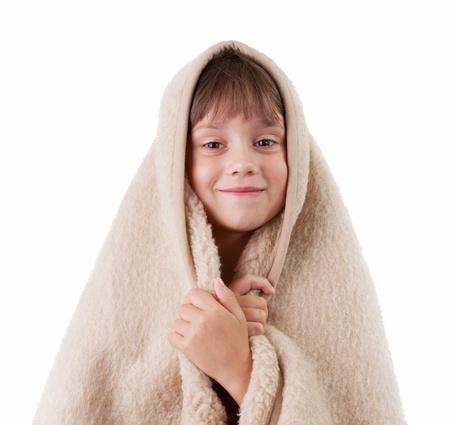 bedcover: Little girl is basking under a woolen blanket