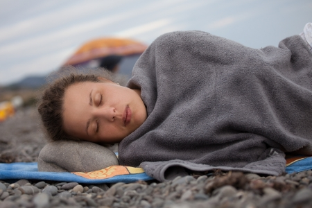 Beautiful young woman lying on the beach sheltered Stock Photo - 16986526