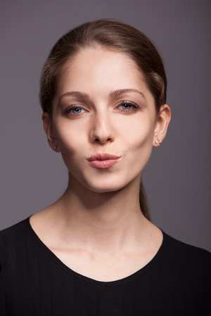 Beautiful young woman with a kiss on the lips photo