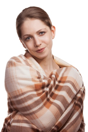 Beautiful young woman hid plaid wool blanket Stock Photo - 16987381