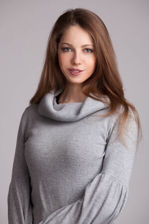 Beautiful young woman in a gray wool sweater Stock Photo - 17008264
