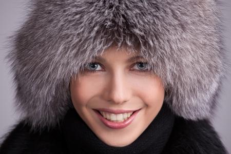 fur coat: Beautiful woman in a fur hat and coat