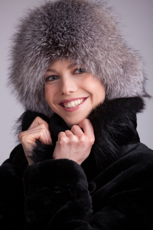 Beautiful woman in a fur hat and black coat Stock Photo - 17018978