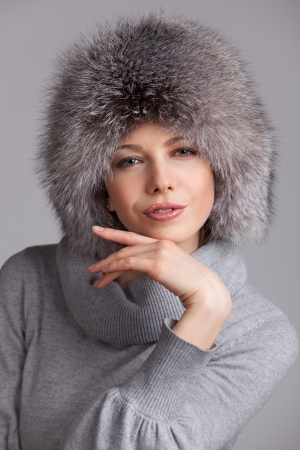 Beautiful young woman in a stylish fur hat Stock Photo - 17040708