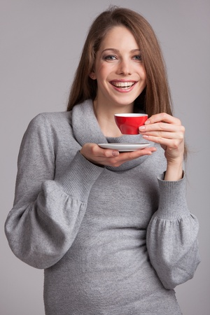 Beautiful brunette with red cup of coffee Stock Photo - 17053443