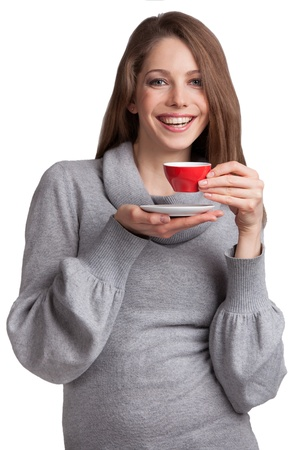 Pretty smiling brunette with red cup of coffee Stock Photo - 17053442