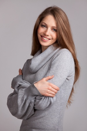 Beautiful woman in a gray wool knit sweater Stock Photo - 17053447