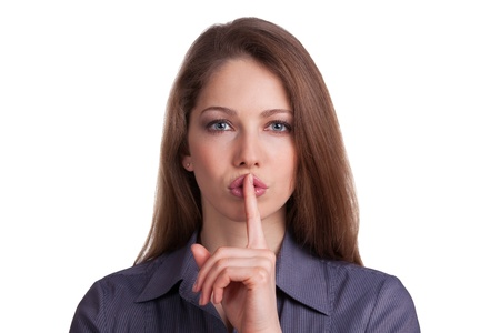 Stylish woman calls for silence, finger on lips Stock Photo - 17077341