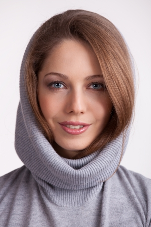 Beautiful charming girl in a wool gray sweater Stock Photo - 17077343