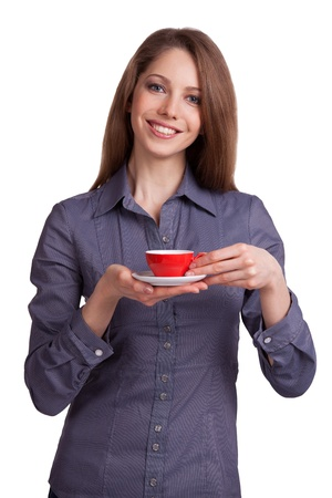 Young woman drinking coffee from a red cup Stock Photo - 17076298